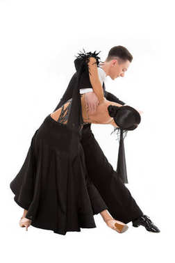ballroom dance couple in a dance pose isolated on white background. ballroom sensual proffessional dancers dancing walz, tango, slowfox and quickstep