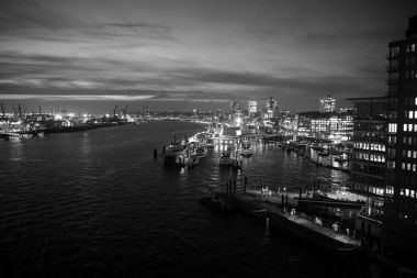 Sea port with ships and cranes in Hamburg, Germany