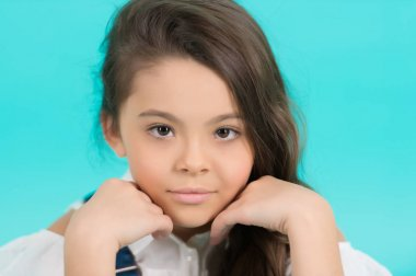 Child with on adorable face on blue background