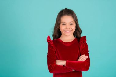 Child smile in red dress, fashion