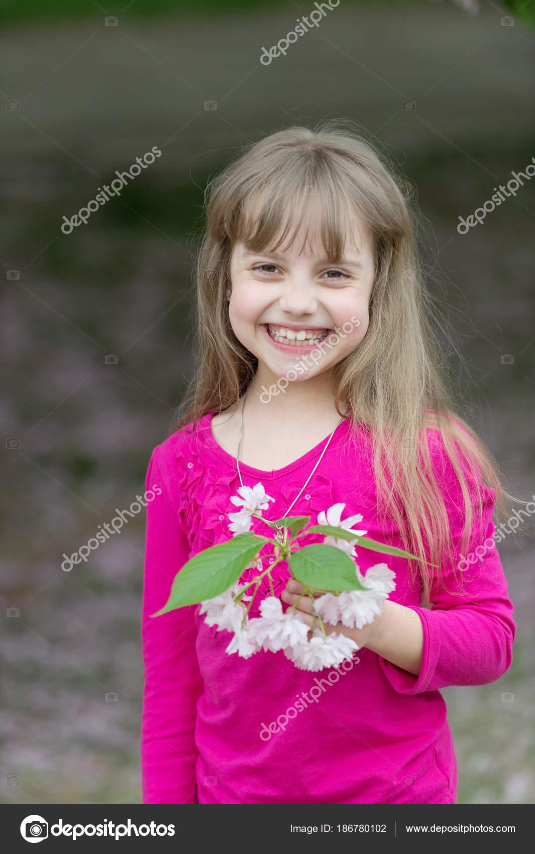 small baby girl hold spring sakura flower — stock photo © stetsik