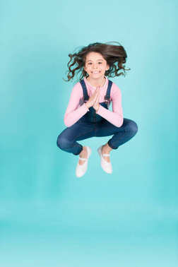 Small girl happy jump in yoga pose, energy