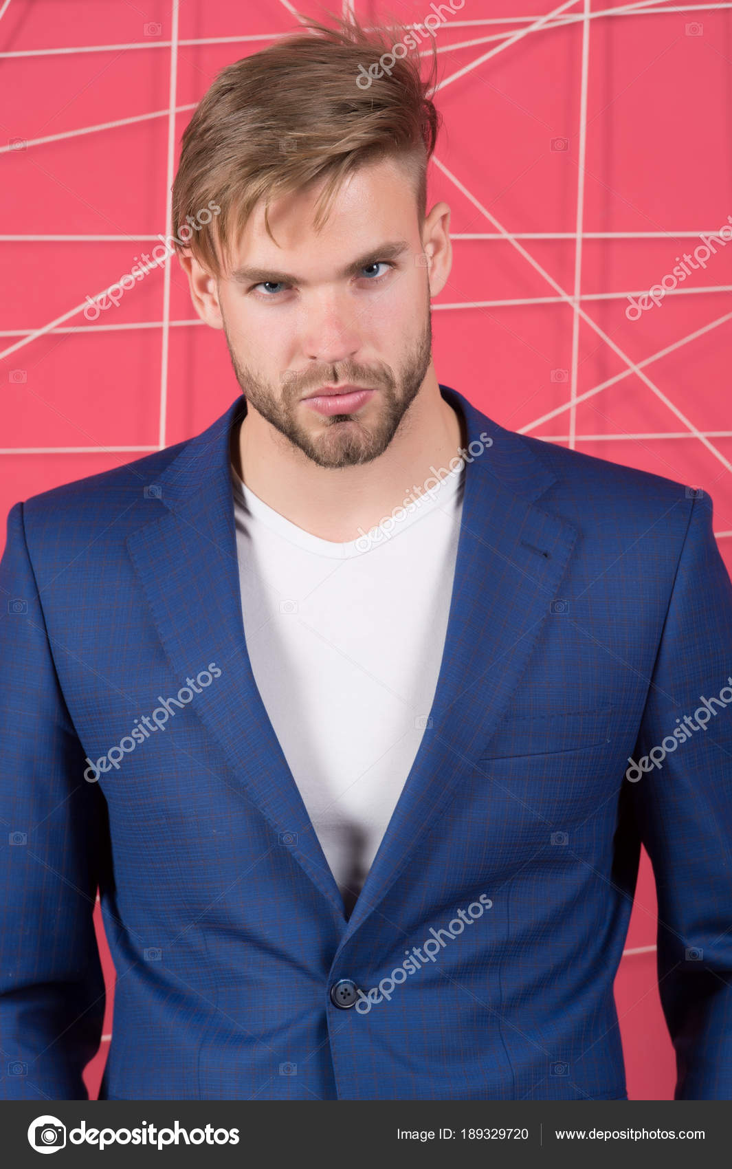 Man in formal suit jacket and tshirt, fashion. Businessman