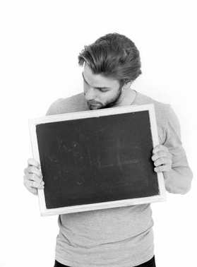 surprised handsome man holding blackboard isolated on white back