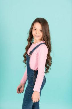 Little girl pose in jeans overall, fashion