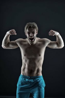 Angry sportsman show strong triceps and biceps muscles. Bearded man shout with anger, health. Athlete guy with fit bare torso, fitness. Mens health, bodycare, wellness, vintage
