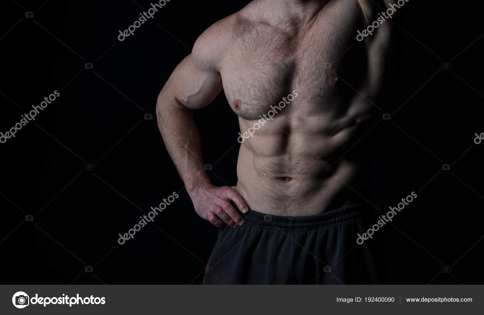 Torso With Six Pack And Ab Muscles Arm With Strong Biceps And