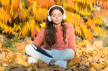 Schoolgirl study. Girl read book autumn day. Self education concept. Child enjoy reading. Visual and audio information. Little child enjoy learning at backyard. Kid study with book. Study every day