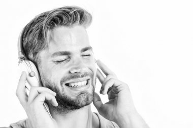 Melody put over various types of music. It is great time to be creating new realities. Man handsome bearded guy listening music headphones white background. Music fan concept. Audiovisual spectacular