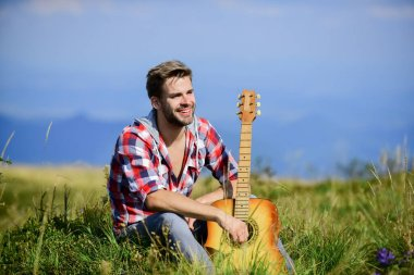 Dreamy wanderer. Wanderlust concept. Inspiring nature. Musician looking for inspiration. Summer vacation highlands nature. Pleasant time alone. Peaceful mood. Guy with guitar contemplate nature