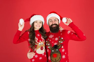 Bearded man and kid. Happy family celebrate holiday. Happy new year. Waiting santa claus. Happy together. Merry christmas. Dad and daughter winter sweaters celebrate new year. Winter holidays