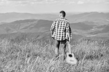 Play What you Want. western camping and hiking. happy and free. cowboy man with muscular torso. acoustic guitar player. country music song. sexy man with guitar in checkered shirt. hipster fashion