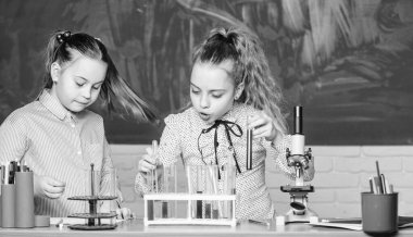 biology education. students doing biology experiments with microscope in lab. Little kids learning chemistry in school laboratory. Biology equipment. Happy children. Biology lesson. Discovering cure