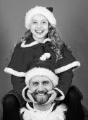 Happy childhood. Christmas family holiday. Father christmas concept. Make holiday extra special. Celebrate christmas together. Christmas family tradition. Dad in santa costume and daughter cute kid