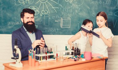 back to school. biology education. Microscope. experimenting with chemicals or microscope at laboratory. Biology school laboratory equipment. happy children teacher. Scientist at work