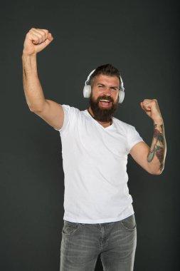 Dj career. Sound producer. Application for listening. Lifestyle music fan. Man listening music wireless headphones. Hipster headphones gadget. Inspiring song. Music library. Bearded guy enjoy music. stock vector