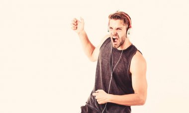 Musician enjoying solo singing. new technology in modern life. sexy muscular man listen music. man listen new song isolated on white. unshaven man in blue tooth technology earphones. moder life