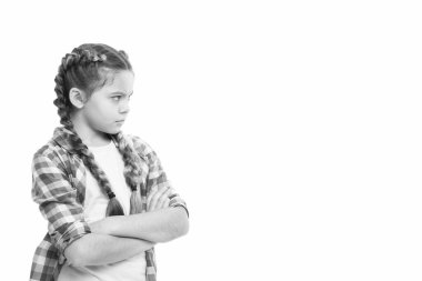 Stubborn child. Disagreement and stubbornness. Girl serious face offended. Kid looks strictly. Girl folded arms on chest looks serious copy space white background. Stubborn temper. Stubborn concept