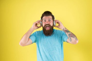 Music is the voice of soul. Bearded man listen to music. Hipster wear headphones playing music. Audio performance. Fun and entertainment. Music is what feelings sound like