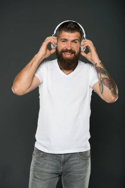 Perfect sound. Listen music for motivation. Favorite track list. Wireless headphones. Modern headphones concept. Man mature handsome listening music headphones gadget. Singing lyrics. Hobby concept
