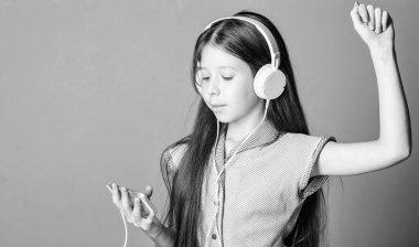 Listen for free. Enjoy music concept. Music app. Audio book. Educative content. Study english language with audio lessons. Girl listen music modern headphones gadget. Perfect sound. Having fun