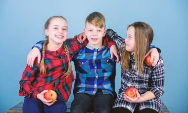 Natural food will do you good. Small group of little children holding natural red apples. Natural joy in healthy eating. Natural food is good for childrens health