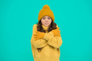 how to keep warm. no flu. get ready for winter holiday. knitted clothes in trend. cold season fashion. keep yourself warm. winter activity for kids. small girl in sweater. hat and gloves accessory