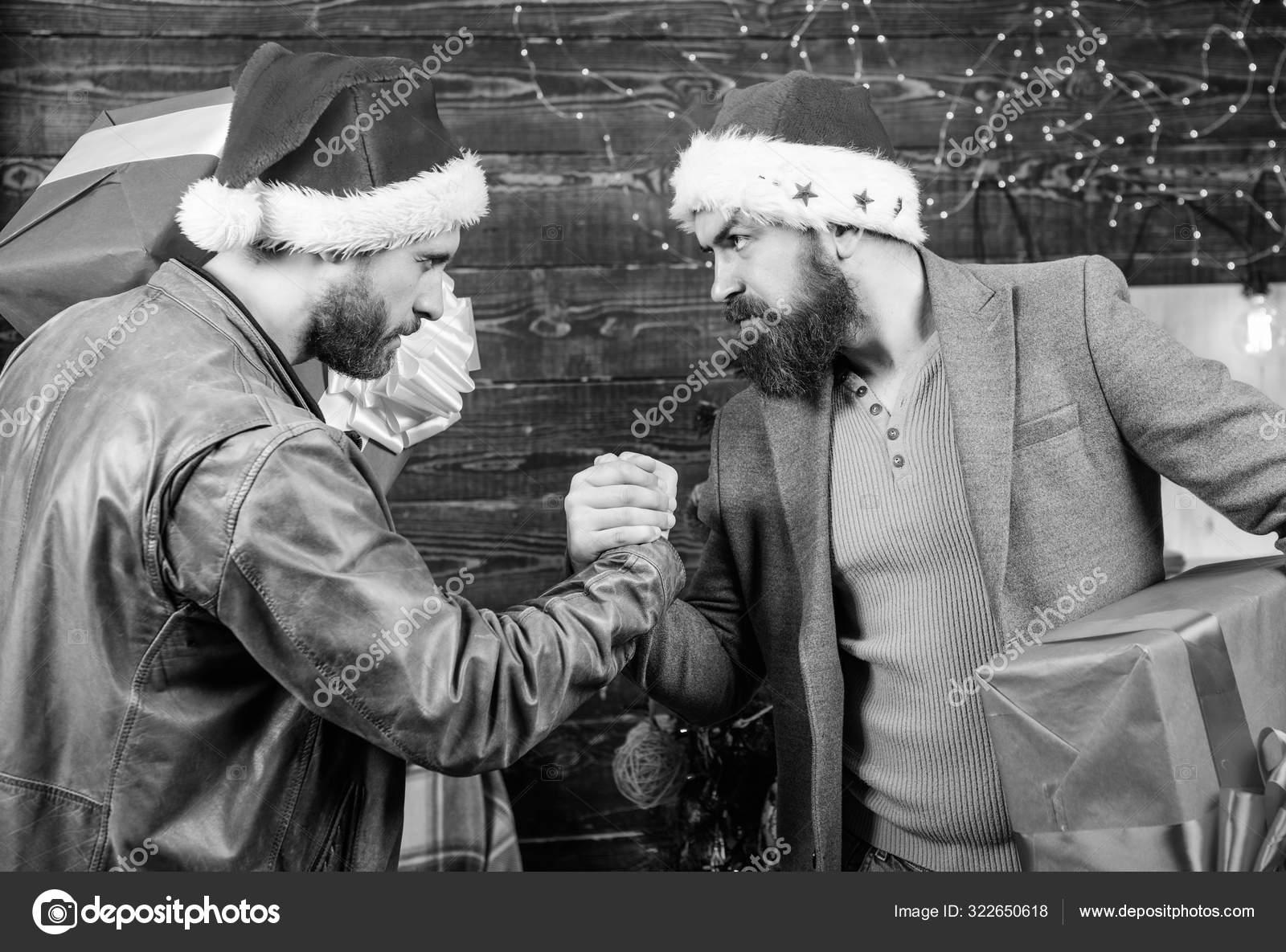 Bearded men carry present boxes. Brutal