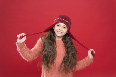 small child ready for winter. kid fashion. Warm knitting tips. happy girl in earflap hat. holiday activity outdoor. seasonal health care. carefree childhood happiness. Healthier hair from root to tip