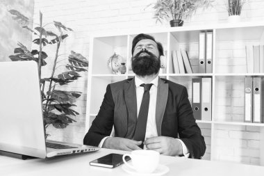 Give yoursel a break. Businessman relax during break time. Bearded man listen to music at work break. Employer in formal suit enjoy rest break. Rest and timeout. Music and relaxation