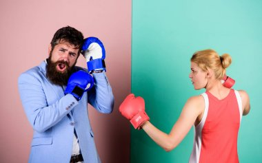 Couple in love fighting. problems in relationship. sport. bearded man hipster fighting with woman. family couple boxing gloves. knockout punching. who is right. win the fight. Strength and power. stock vector