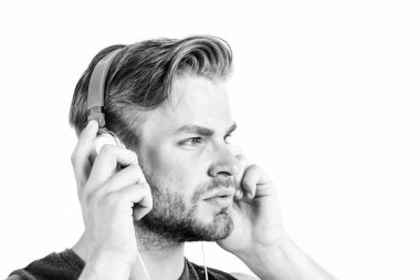 Good music increases my productivity. sport music. joy and relax. sexy muscular man listen sport music. man in headset isolated on white. unshaven man in blue tooth headphones