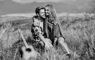 Expressing feelings. country music. romantic date. happy friends with guitar. western camping. hiking. friendship. campfire songs. men play guitar for girl. couple in love spend free time together
