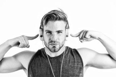 Bearded man wearing adjustable headset. relax playlist. sexy muscular man listen music from playlist. man relax in earphones isolated on white. unshaven man relax with favorite song