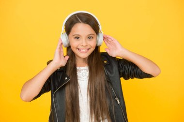 school radio dj. lady DJ long hair. happy smile. hipster urban style girl. lifestyle concept. biker kid in headset. small girl in leather jacket. autumn fashion style. child listen rock music