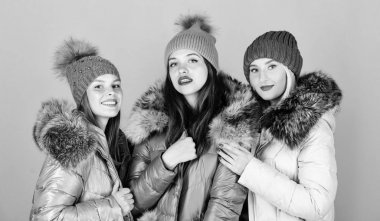 It is cold outside. women in padded warm coat. family christmas. happy winter holidays. Friendship. flu and cold. seasonal shopping. winter clothing fashion. faux fur down jacket. girls in beanie