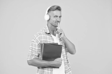 Audio library. Man handsome college student headphones books. Study languages. Another way of study. Learning english. Educational technology. Study. Audio book concept. Worldwide knowledge access