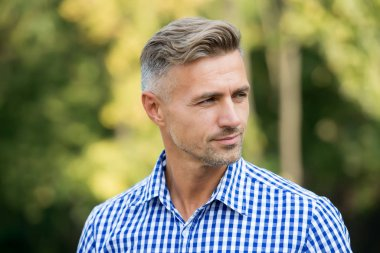 Handsome and confident. Handsome man on summer outdoor. Mature person with handsome face. Fashion and style. Grooming and style for older men. Handsome and well groomed