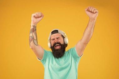 Bass low sound. Hipster headphones gadget. Inspiring song. Music library. Feel rhythm. Bearded guy enjoy music. Equalizer player settings. Lifestyle music fan. Man listening music wireless headphones