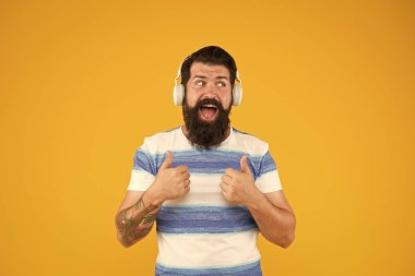 happy bearded meloman headphones. mega hits. summer in the city. free time. Summer playlist. summer music mix. Man hipster listen song yellow background. enjoy summer vacation. Melody for relax