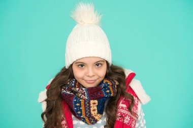Dress in layers and wear hat. Stay active. it is cold outside. kid warm knitwear. winter vibes. Portrait of smiling girl hipster. Youth street fashion. Winter fun. feeling cold this season