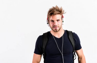 I am online. new technology in modern life. sexy muscular man listen music. man listen new song isolated on white. unshaven man in blue tooth technology earphones. moder life concept