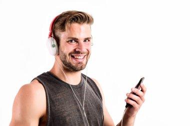 Listen music for motivation and inspiration. Audio quality. Inspiring music concept. Man handsome unshaven hipster listen music using headphones gadget. Modern earphones. Music application smartphone
