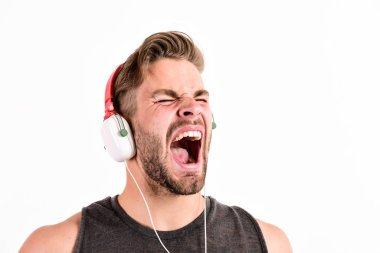 Excellent sound modern equipment. Enjoy every sound. Modern earphones. Pure sound. Inspiring music concept. Man handsome unshaven hipster listening song using headphones gadget white background