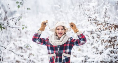 Cheerful girl outdoors. joyful and energetic woman. skiing holiday on winter day. beautiful woman in warm clothing. Enjoying nature wintertime. Portrait of excited woman in winter
