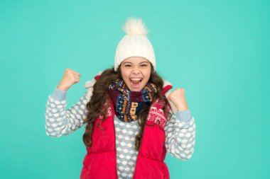 finally vacation time. Stay active this season. kid wear knitted warm clothes. just have fun. winter vibes. Portrait of happy girl hipster. Youth street fashion. Winter fun. feeling good any weather