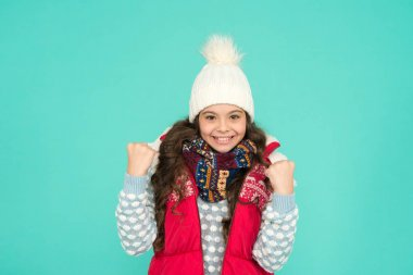 Successful kid. Stay warm and stylish. Cold winter days. Vacation time. Stay active during season. Kid wear knitted warm clothes. Winter vibes. Youth street fashion. Winter fun. Feeling good