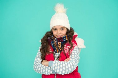 Youth street fashion. Winter fun. Feeling good any weather. Child care. Stay warm and stylish. Cold winter days. Vacation time. Stay active during season. Kid wear knitted warm clothes. Winter vibes