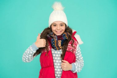 Good choice. Stay warm and stylish. Cold winter days. Vacation time. Stay active during season. Kid wear knitted warm clothes. Winter vibes. Youth street fashion. Winter fun. Feeling good any weather