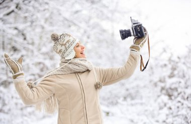 ready for weather forecast. expedition. winter girl with vintage camera. happy woman make selfie on camera. winter selfie. having fun outdoor snowy forest. cold weather brings good mood